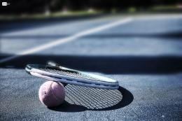 Tennis Racquet on a ball