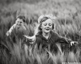 Lovely Kids running along the grassy field 183