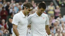 Roger Federer [right] and Novak Djokovic embracing after the 1303