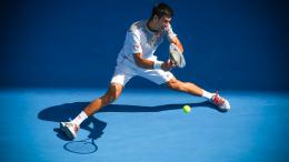 novak djokovic plays a backhand in his fourth round match during day 1291