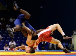pins Canada Ryley Walker during their men\'s freestyle 60kg wrestling 1369