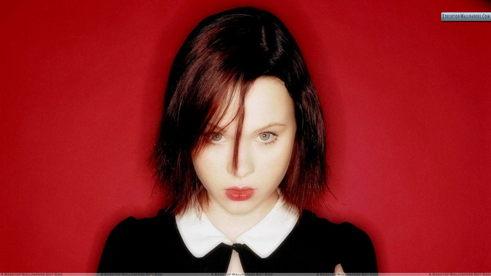 Thora Birch Looking Front Red Lips And Background 978