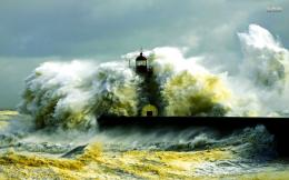 Waves crashing in the lighthouse wallpaper 1680x1050 543