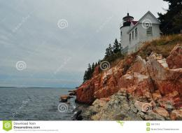 quaint lighthouse on the coast of Maine perched above a rocky cliff 1856