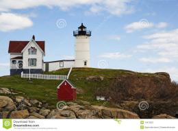 Scenic view of lighthouse on cliff with blue sky and cloudscape 1360