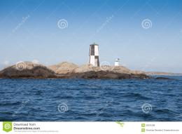 Old lighthouse on a cliff in the western part of the swedish coast 1856