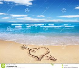 Heart with arrow, as love sign, drawn on the beach shore, with the sea 119