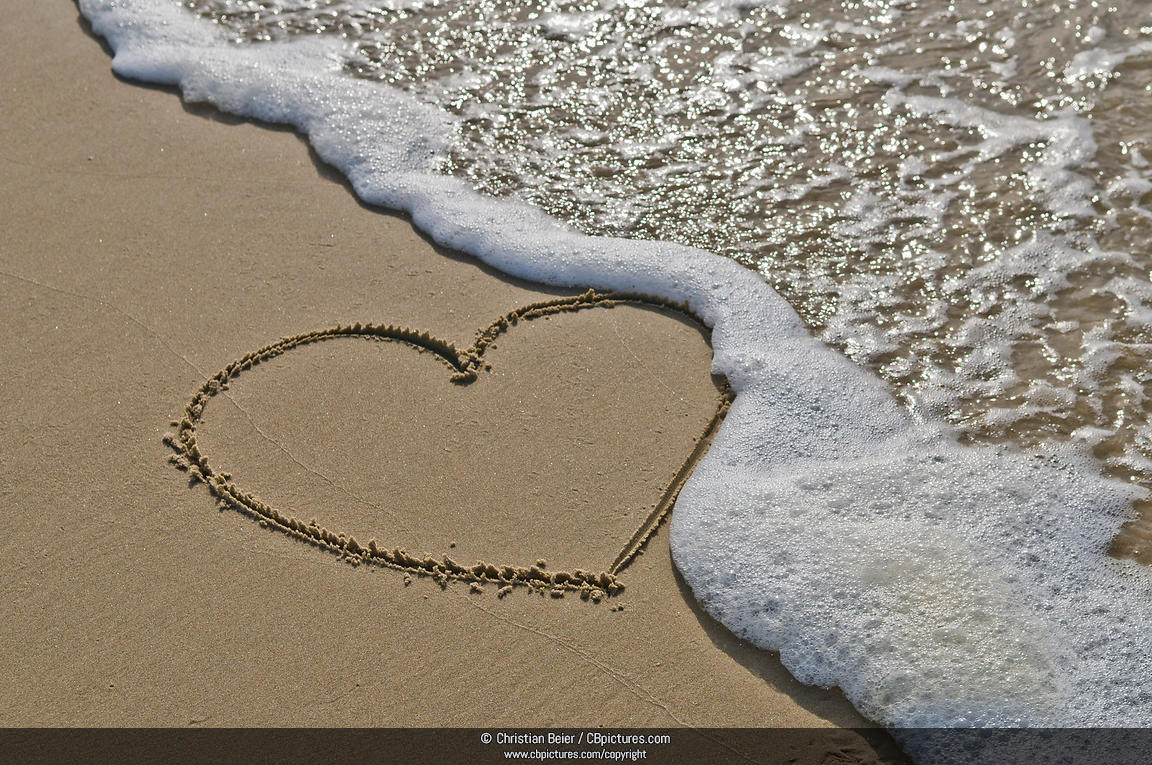Heart drawn in sand on the beach, Symbol for the transience of love 1289