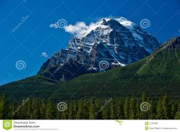snow covered mountain top pierces the blue sky in Banff National 944