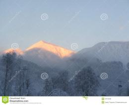 Royalty Free Stock Image: Snowy mountain top at sunset 785