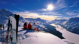 Download People sitting on the top of snow mountain Switzerland High 298