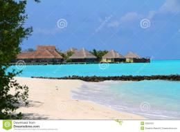 in embudhoo finolhu island showing beach and overwater bungalows 660