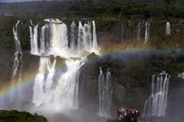 rainbow forms over tourists visiting Iguazu Falls in Foz do Iguazu 233