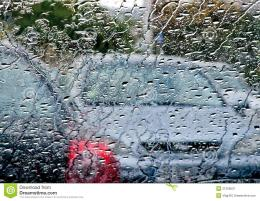Photo of cars in the rain across the windshield 538
