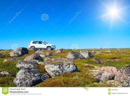 White off road vehicle on peak of green hillCoast of Kola Peninsula 779