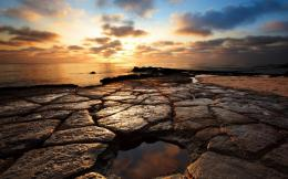 rocks on a beach at sunset hd wallpaper wallpaper list puzzled rocks 566