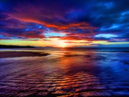 File Name : Free beautiful wallpaper of a sunset over the beach at red 1618