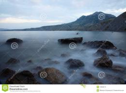 Twilight over the sea and stones in the water 1118