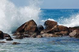 Waves breaking against the rocks — Stock Photo © DmitryRukhlenko 355
