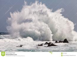High wave breaking on the rocks of the coastline 1198