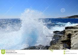 Powerful waves breaking on rocky coastline 471