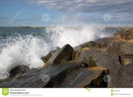 Scenic view of waves breaking on rocky coastline 115