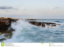 Big sea waves breaking at rocks and stonesEvening seascape 973