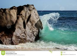 Wave Breaking Against Rock Royalty Free Stock ImageImage: 611056 484