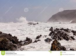 High wave breaking on the rocks of the coastline 602