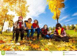 , sitting on the bench in autumn park on sunny day and draw pictures 104