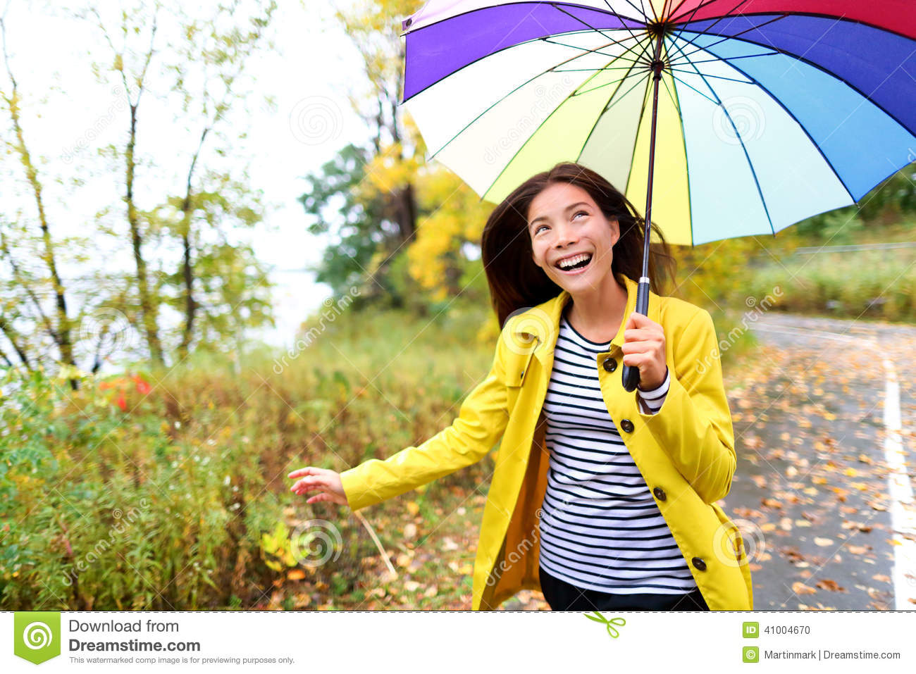 rainy fall day wearing yellow raincoat outside in nature forest by 216