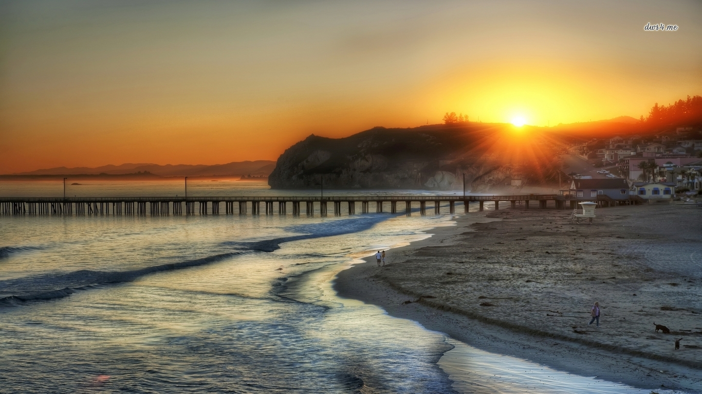 Amazing sunset sun hiding behind the hill by the pier wallpaper 767