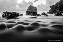 Black and White image of beautiful standing waves and rock formations 879
