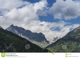 Beautiful mountain landscape with clouds and snow capped peaks 923