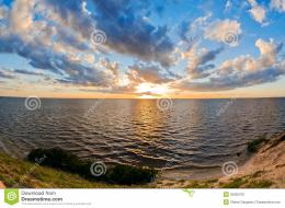 Beautiful sunset over the smooth surface of a mountain lake 517