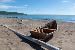 Wooden fishing boat on the sea shore— Stock Photo © Stas K 1510