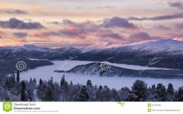 with the first sun over snow covered mountains landscape in Norway 810