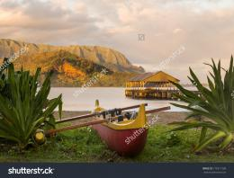 Hanalei pier at dawn as the sun lights the sky over Na Pali mountains 582