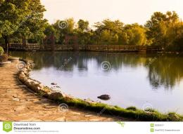 Autumn lake with a footbridge at sunset 1474