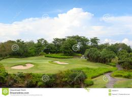 Golf course in luxury resortLarge golf green field on the background 1703