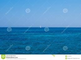 Lonely Yacht In An Open Sea Under Solid Blue Sky Stock ImagesImage 223