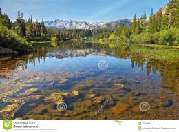 magnificent mountains are reflected in the smooth waters of a mountain 1005