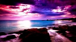 Beautiful magenta sky over seashore rocks:High Contrast 1890