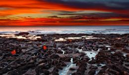 Magnificent red sunset over seashore rocks 1024x600 1263