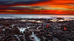 Magnificent red sunset over seashore rocks wallpaper 1886