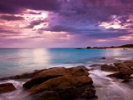 Beautiful magenta sky over seashore rocks 1024x768 1996