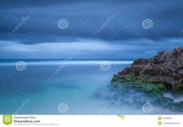 Blue Beach Scene With Rock Stock PhotoImage: 44095899 213