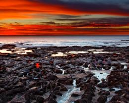 Magnificent red sunset over seashore rocks 1280x1024 134
