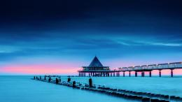 Long pier water sea clouds sunset bridges 1600x900 1395
