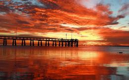 Sunset over pier water sky sea clouds 1280x800 207
